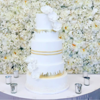 Five tier white and gold wedding cake