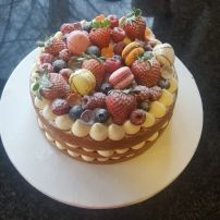 Elegant three tier fresh fruit cake